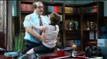 Дядя Митя открывает сейф в кабинете директора школы