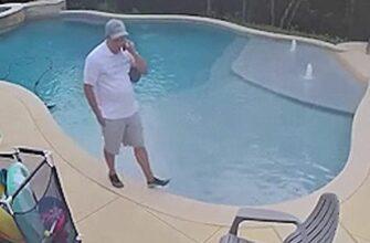 Реакция мужчины на падение в бассейн