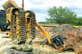 Попытка достать трактор из грязи не удалась